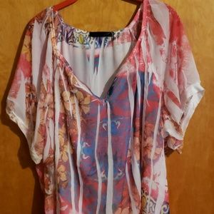 Semi Sheer floral blouse.